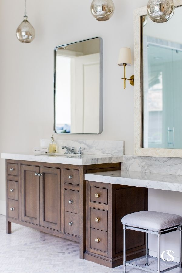 Breaking up a two sink bathroom cabinet design with a shorter vanity in the middle adds a ton of visual interest to your bathroom.