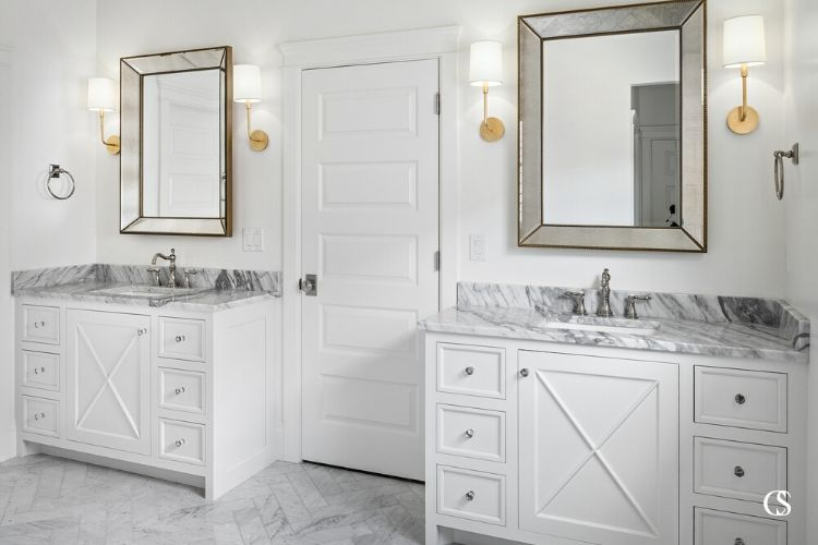 Custom bathroom cabinet design can combine multiple aesthetics, like the modern and farmhouse looks you see coming together in these matching bathroom vanities.