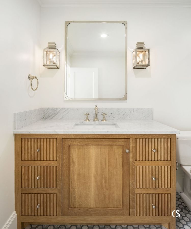 The vertical pattern on the drawers of this custom bathroom cabinet design is absolutely everything. Can you imagine it without now that you've seen it??