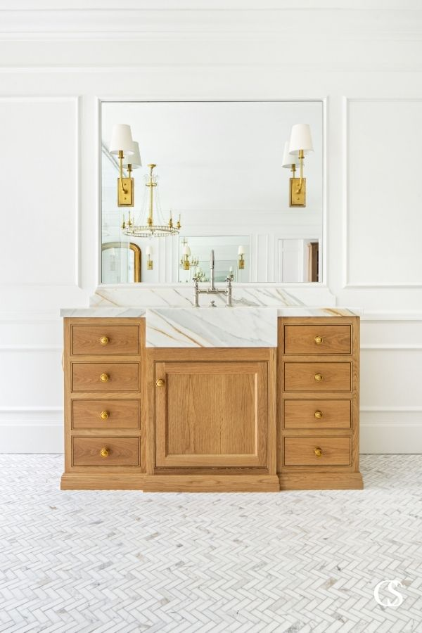 The many design ideas for this cabinet included a marble front sink extending from the countertop to really make a statement.