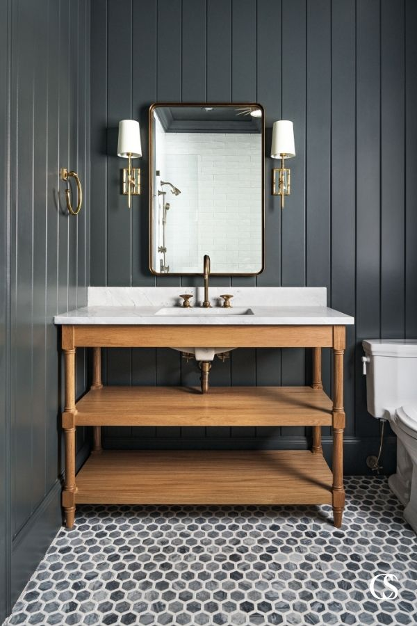 There is something about the combination of the black slat walls, hex tile flooring, and open shelf custom bathroom cabinet that make this room feel perfectly retro modern.