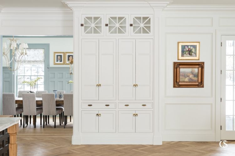 When you've created the best built in custom cabinet, you don't want to hide it. This one provides all the eye candy necessary between the kitchen and formal dining area.