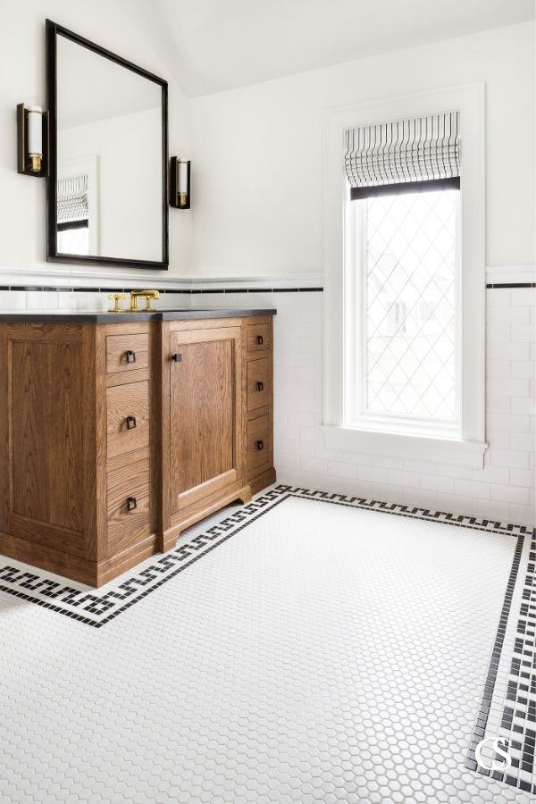 This custom flooring does wonders in helping some of our best custom bathroom cabinet designs feel like they've always belonged in the space.