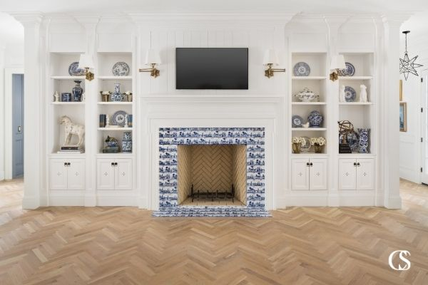 """Sometimes the best custom cabinets in the living room actually flanks the """"entertainment"""" focus, like the tv, and provides plenty of room for displaying family treasures and storing other electronics or games."""