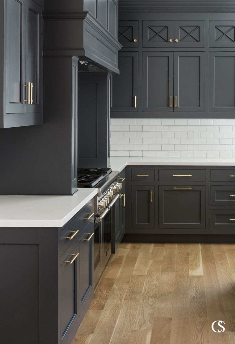 The combination of just the right black paint, perfectly mixed cupboard and drawer faces, and beautiful hardware make this some of the best custom cabinet design for the kitchen we've created.
