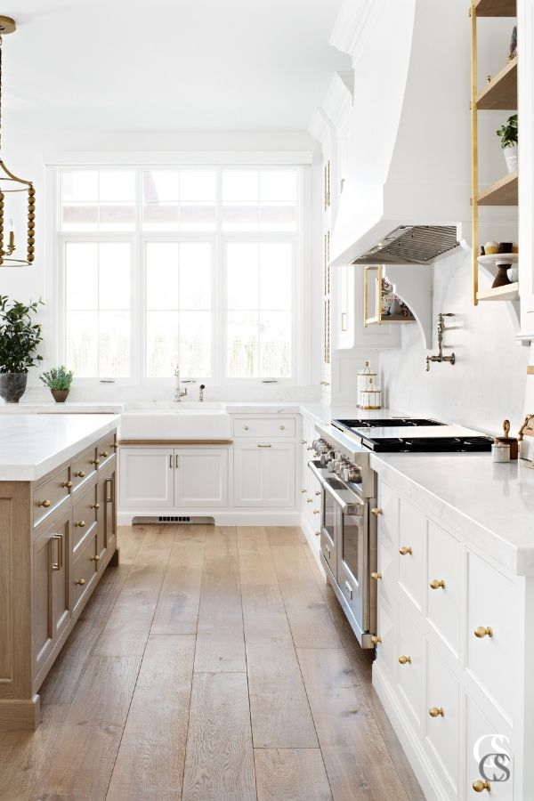 Matching hardware on two complementary cabinetry pieces is a good way to make them feel cohesive and like the best custom cabinets for your kitchen.