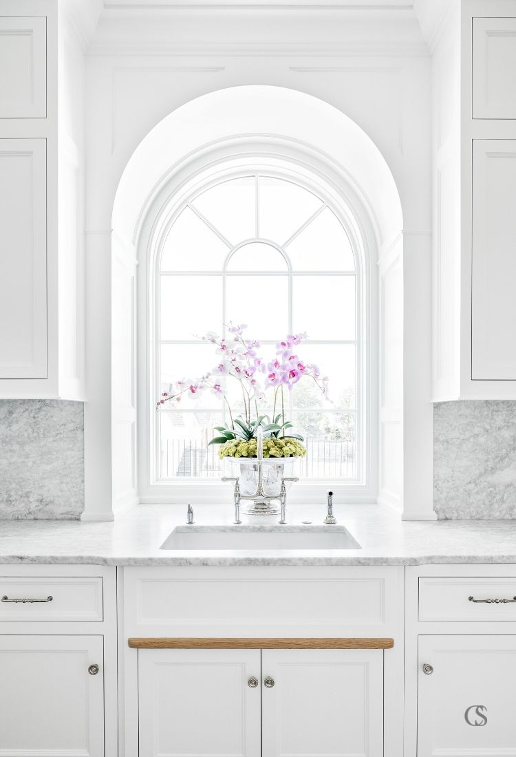 Natural light should always play a part in the best custom cabinets for kitchens, not only for the functional work it does but the beauty it lends the space.