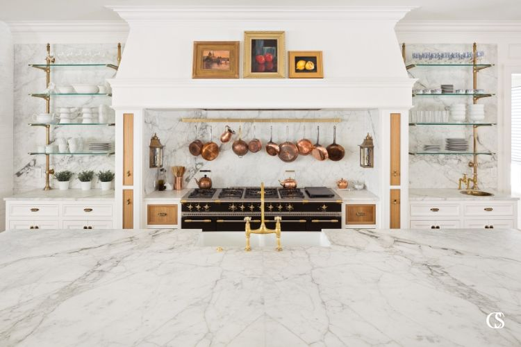 Marble, glass, wood, paint copper, and brass are just a few of the materials that make this some of the most eclectically gorgeous kitchen design out there.