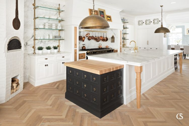 A big kitchen has to make use of its island. The best kitchen island design will incorporate at least one part of your kitchen triangle, plenty of usable counter space, storage, and hopefully room for dining, homework, or chatting!