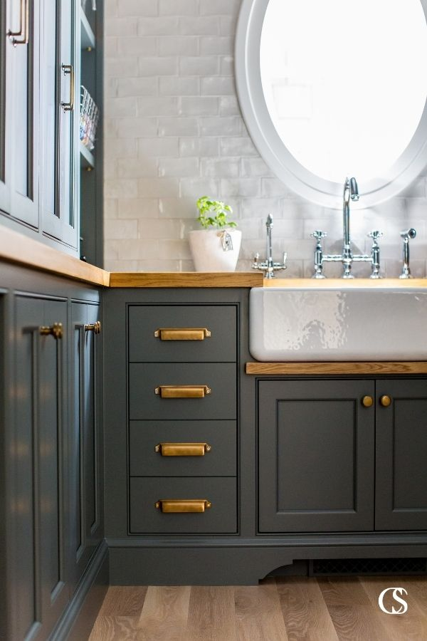 Why not opt for black cabinets in the pantry? Some of the best kitchen pantry design ideas are unexpected but make a beautiful impact in your home.