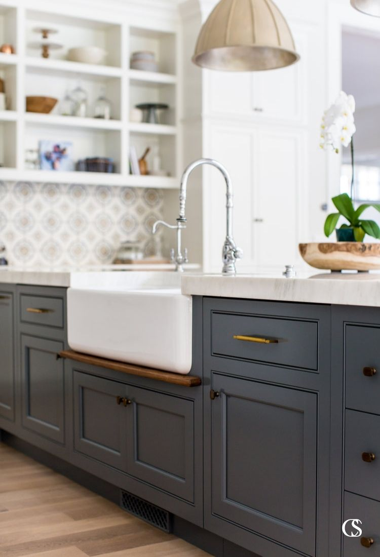 Don't be afraid of color in your kitchen! These blue custom cabinets are the perfect anchor to white paint, custom wall tile, and the perfect kitchen lighting.