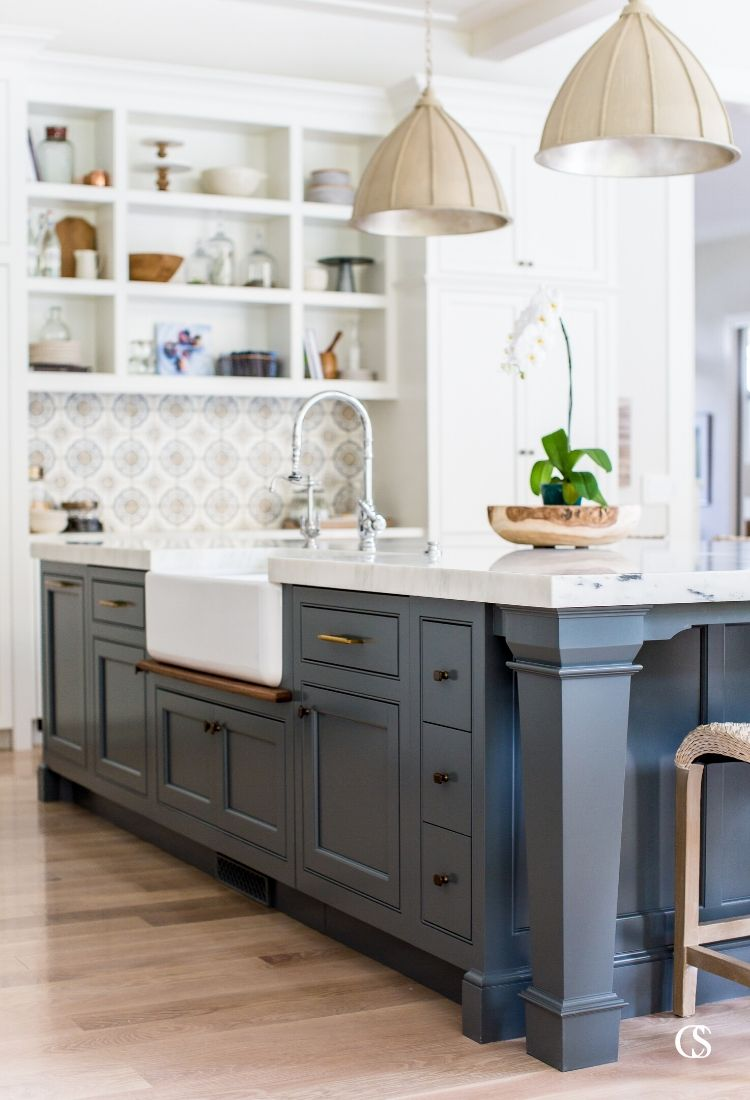 Don't be afraid of color in your kitchen! This blue kitchen island design is the perfect anchor to white paint, custom wall tile, and the perfect kitchen lighting.