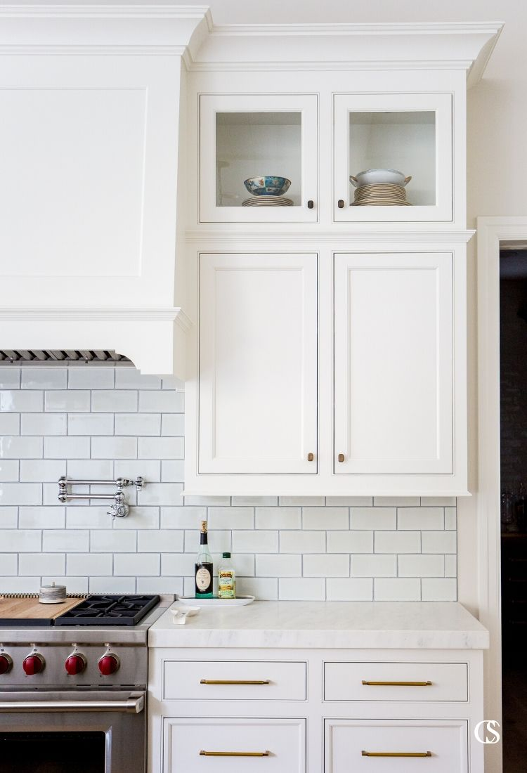 The cabinets for your kitchen should work hard but also provide a little joy—like being able to see your favorite dishes you bought abroad each time you enter the room.