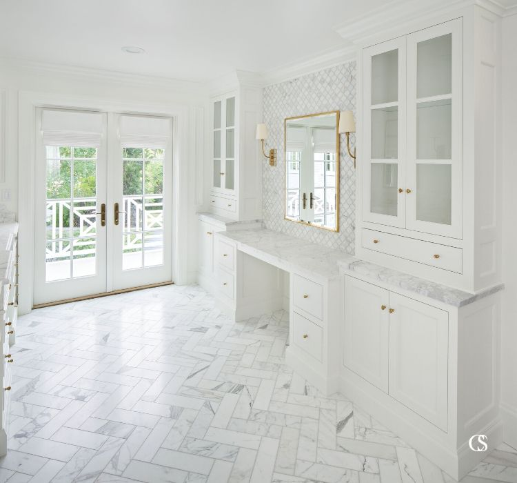 Every angle of this custom bathroom cabinet design is meticulously thought out—like putting the vanity where you can receive the best natural light while getting ready.
