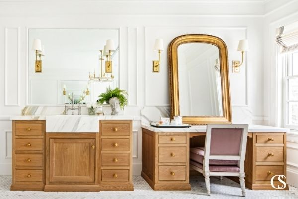 These custom bathroom cabinets feel luxurious stain color to marble countertops.