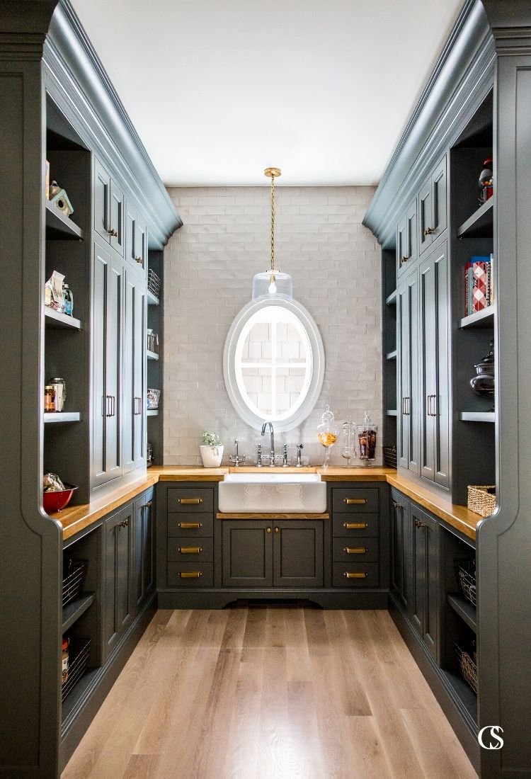 Custom black cabinets are nothing to fear or balk at. Like this statement of a butler's pantry, your home can feel purposefully bold and elegant.