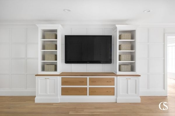 Open shelving is the perfect way to bring lightness to a big entertainment center, but it doesn't mean everything has to be on display. For more of our best custom built in design ideas, check out ChristopherScottCabinetry.com!