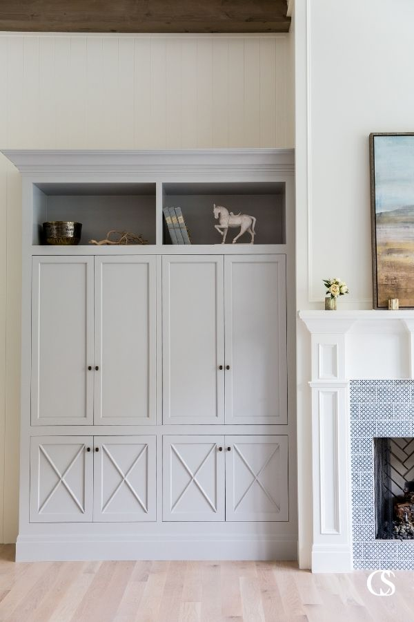 A custom built in entertainment center can be crafted to hide and store your electronics with custom bi-fold cabinet doors like this. Close the doors and you've got a beautiful living room.