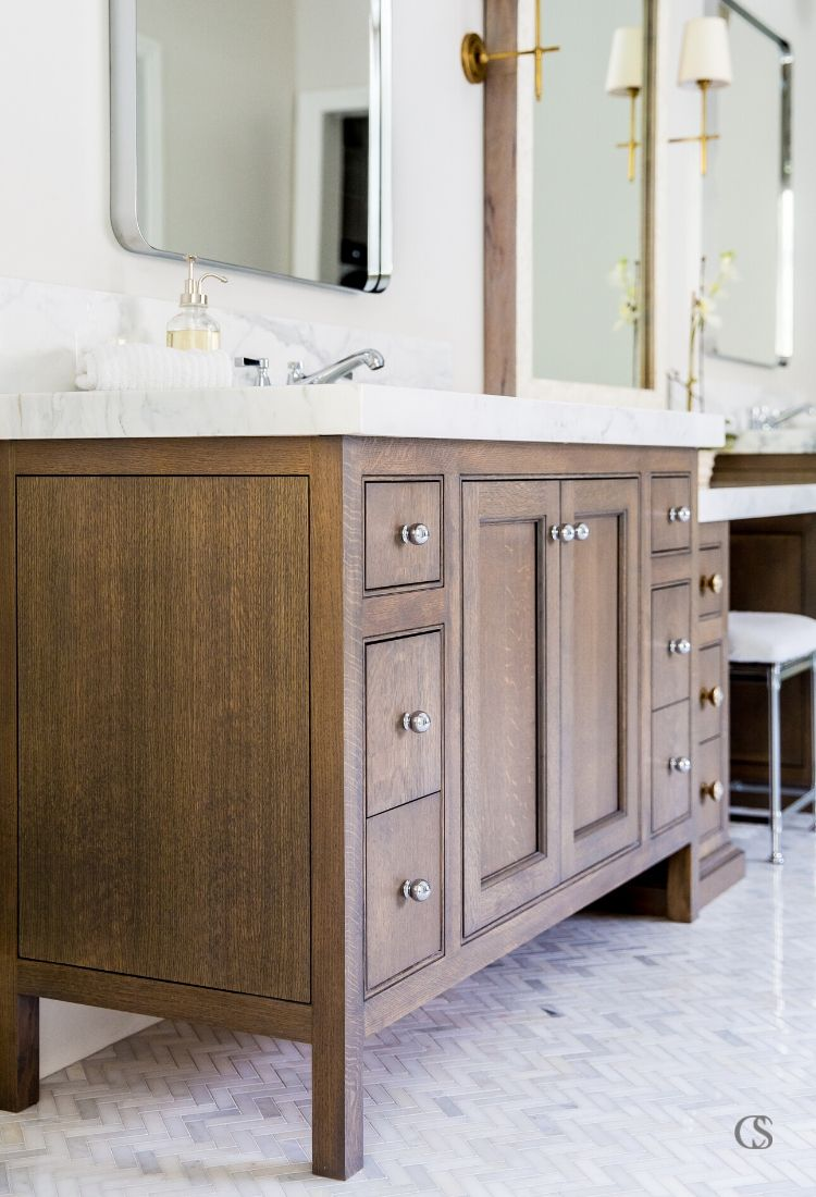 See the way the end piece of this custom cabinet design for the bathroom mimics the lines on the front? It's the details that make custom cabinetry so unique and special.