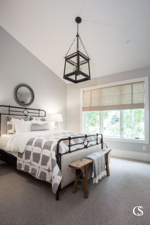 Vaulted ceilings give this custom design for the bedroom a grand feeling the second you walk in.