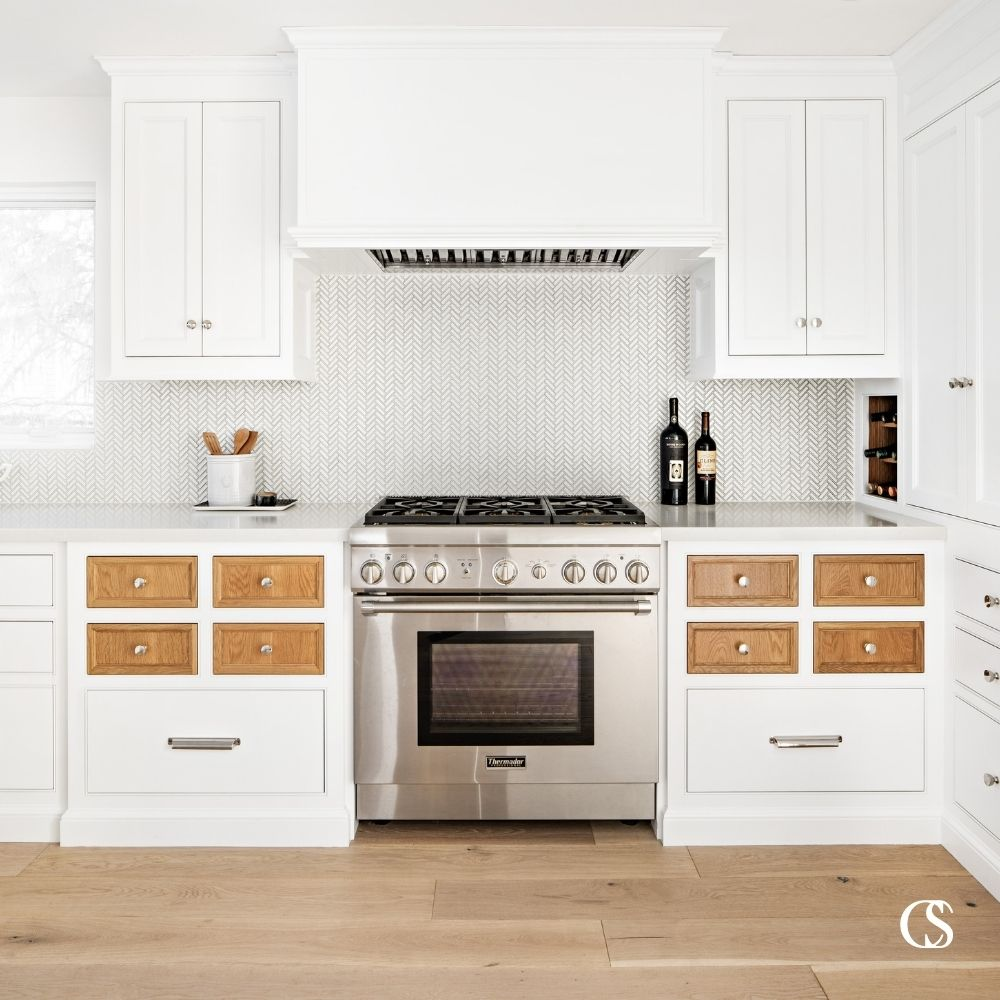 Why not throw a curveball in your custom kitchen? Say...contrasting drawer fronts to add some richness and personality!