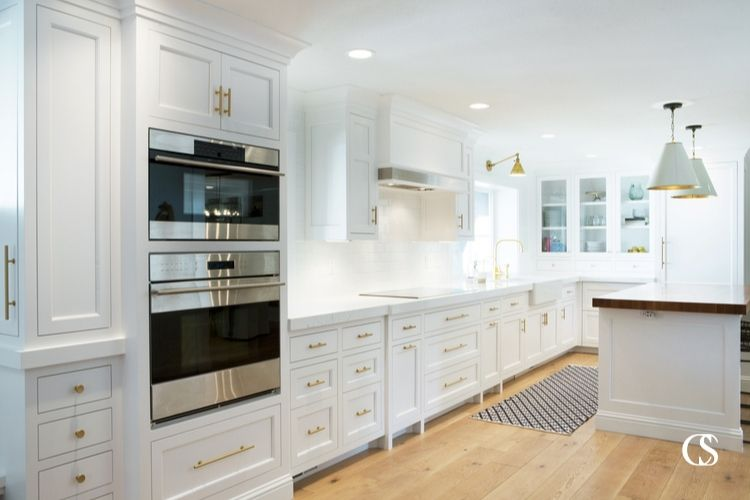 The cabinets in this custom kitchen are varied enough to hold every kitchen gadget under the sun. A variety of drawers and cupboards is super important so your kitchen can serve you best!