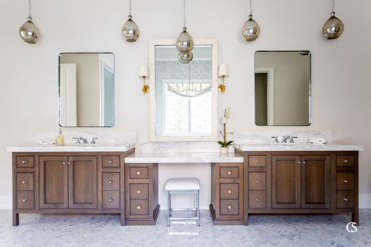 The custom two sink bathroom vanity is as modern a solution as it gets, but the unique bathroom design together evokes a dreamy vintage vibe.