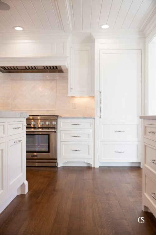 I love the way this custom kitchen cabinet design transitions seamlessly into a shiplap-style ceiling.