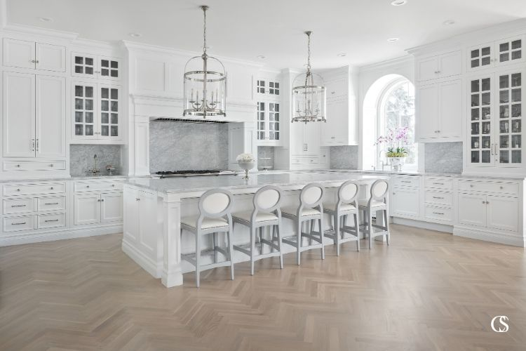 This white kitchen island design creates an anchor for this large room to stay grounded.