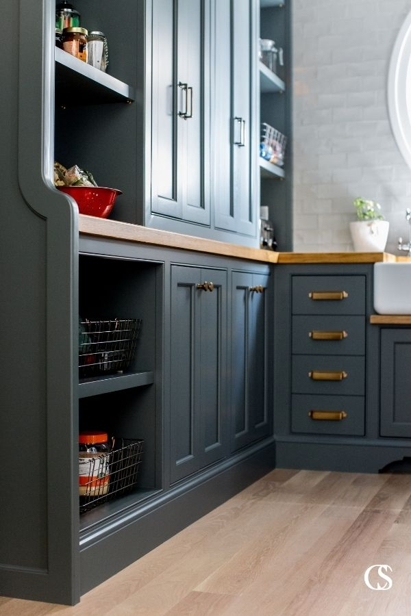 Making space for both closed cupboards and drawers as well as open shelving for things like snack baskets will help ensure your kitchen pantry design ideas fulfill all your family's needs.