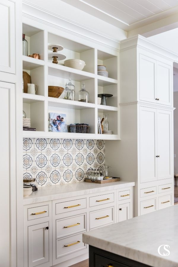 Not every item in your kitchen should be tucked away behind closed doors! Think about which items you'd love to display and design unique custom cabinets around them.