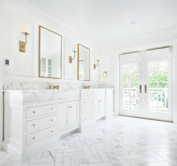White inset cabinetry with white marble countertops, white herringbone floors, and white paint ensure that this white custom bathroom design excludes luxury.
