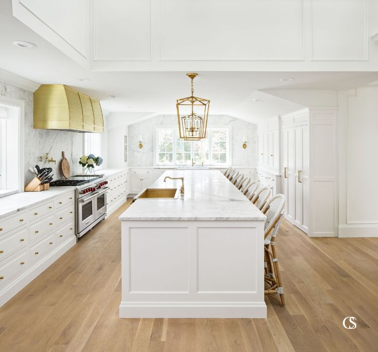 This white kitchen island works hard with a built-in sink, plenty of workspace, and seating for 8!