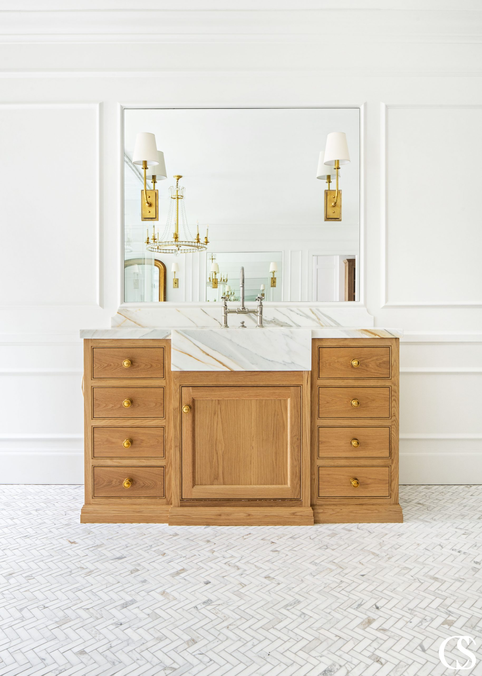 The many design ideas for this cabinet included a marble front sink extending from the countertop to really make a natural statement.
