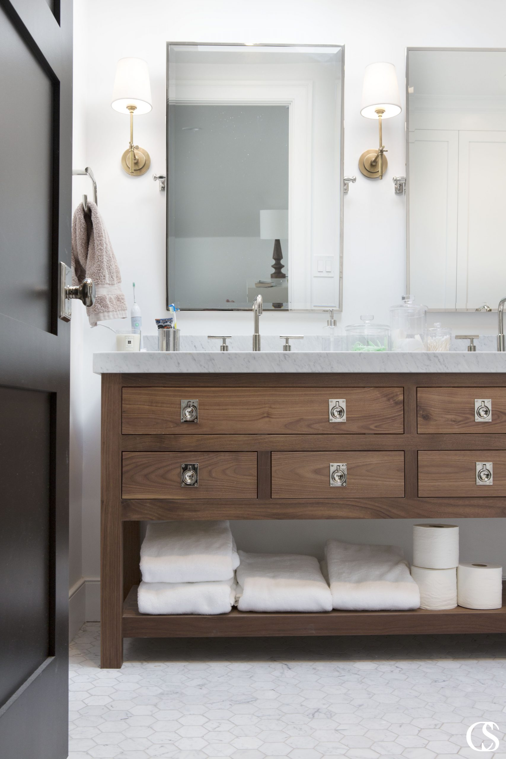 Slab front drawers, distinctive hardware, clean lines...what vanity dreams are made of! This unique custom bathroom cabinet pulls off a look completely different than most bathroom vanities—that's what working with professional cabinet designers will get you.