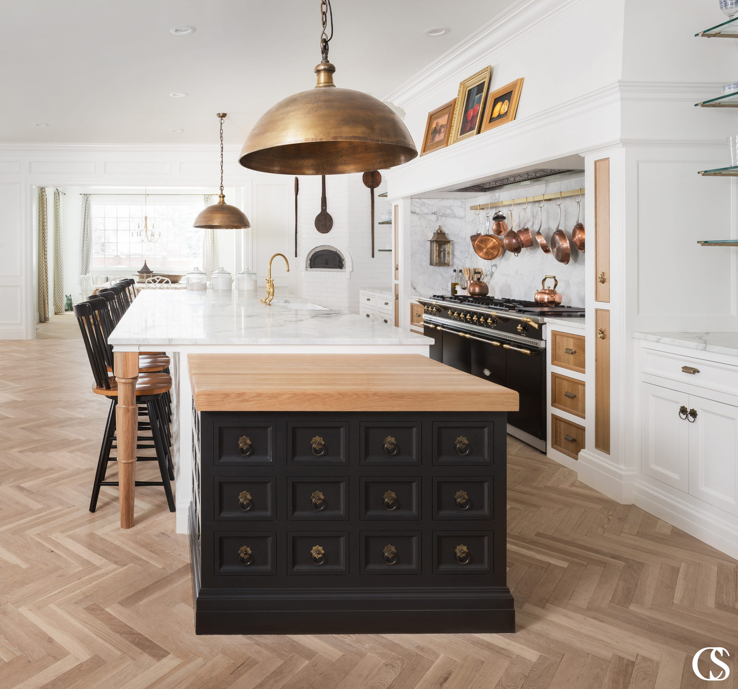 Beautiful custom black kitchen cabinets can have a powerful impact on your home. This unique kitchen island design combines multiple colors, materials, and global influence to reflect a beautifully eclectic style.