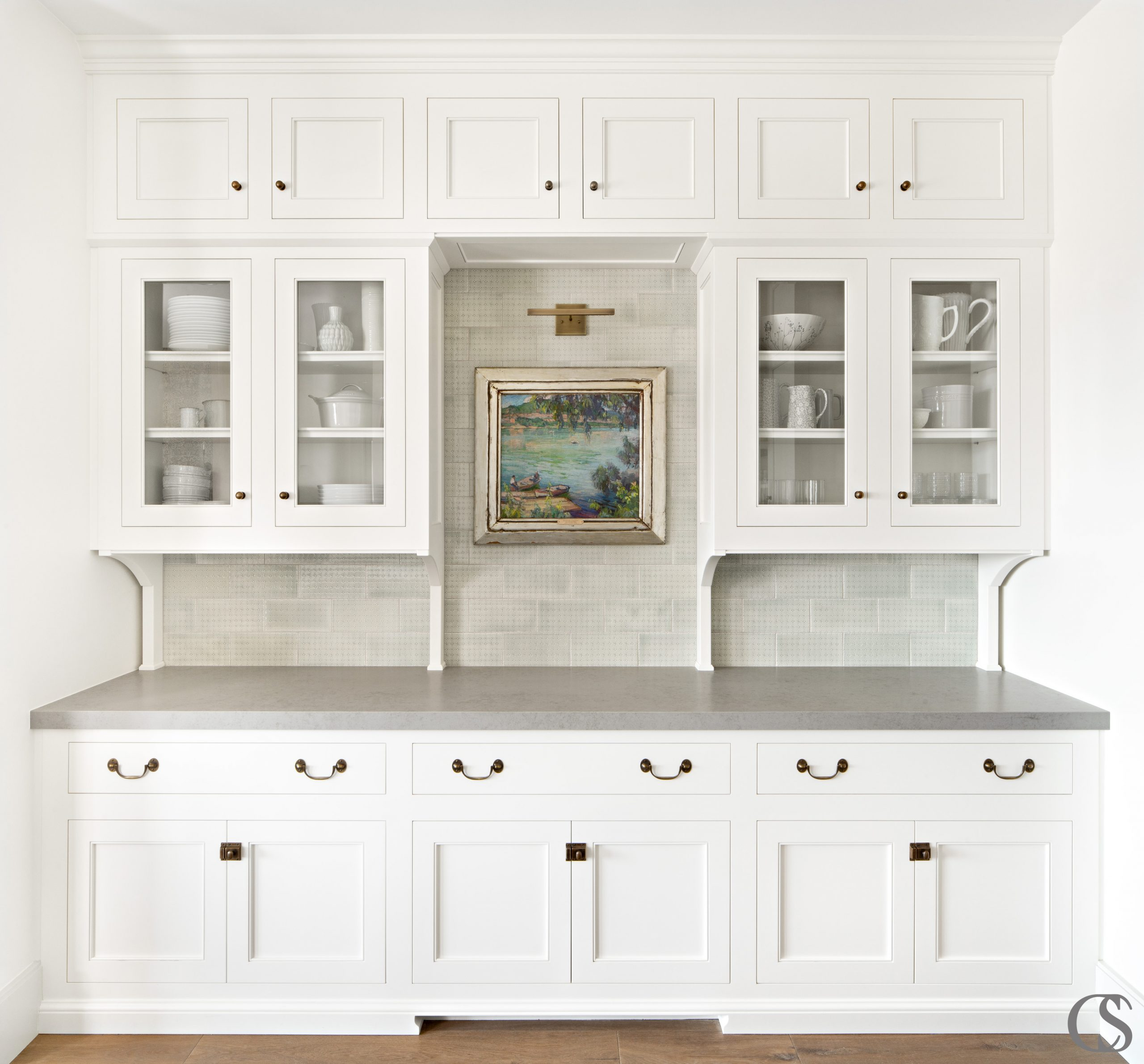 Why not allow for a little museum elegance in your beautiful custom kitchen? Display what's worthy of display, while still getting to tuck away the appliances and other gadgets.