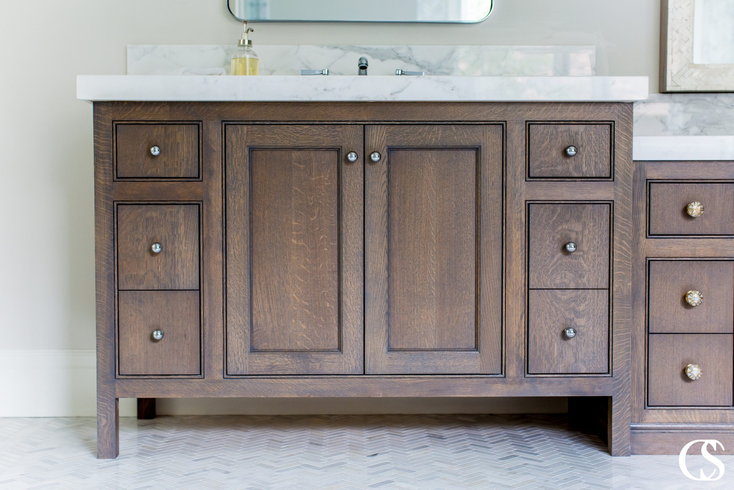 What does the best bathroom cabinet design look like to you? The beaded inset cabinets on this custom vanity frames each drawer and cabinet perfectly to add just enough subtle detail to let you know it was designed with an expert eye.