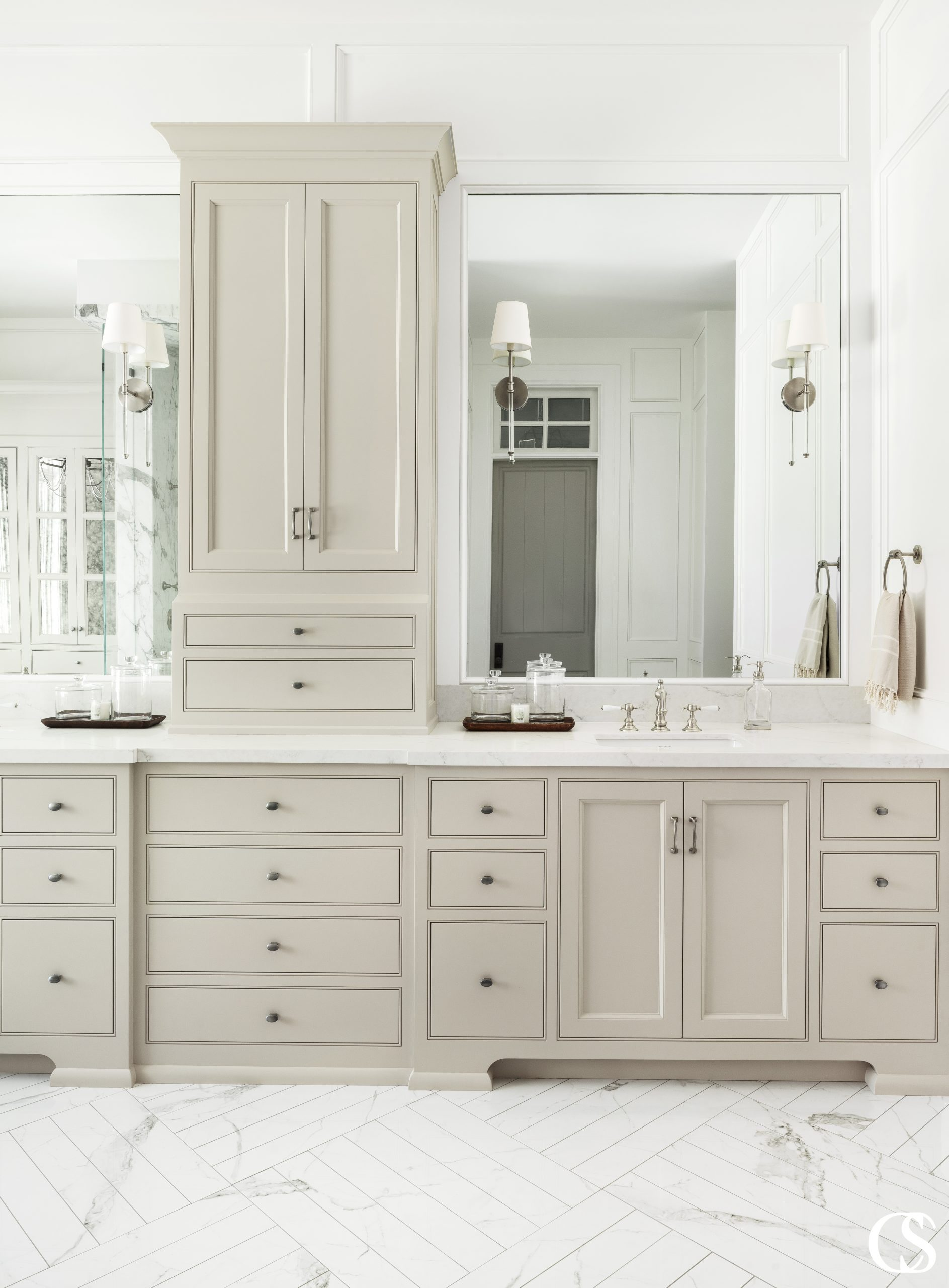 A common misconception with bathroom vanity cabinets is that a vanity is all one cabinet, when in most cases, especially when two sinks are being incorporated, it's a combination of cabinets. The main reason for this is that you may need to fill a width greater than what a single cabinet can fill. Other reasons may be that you need to have a sink cabinet centered on plumbing or want to work in a specific type of storage.