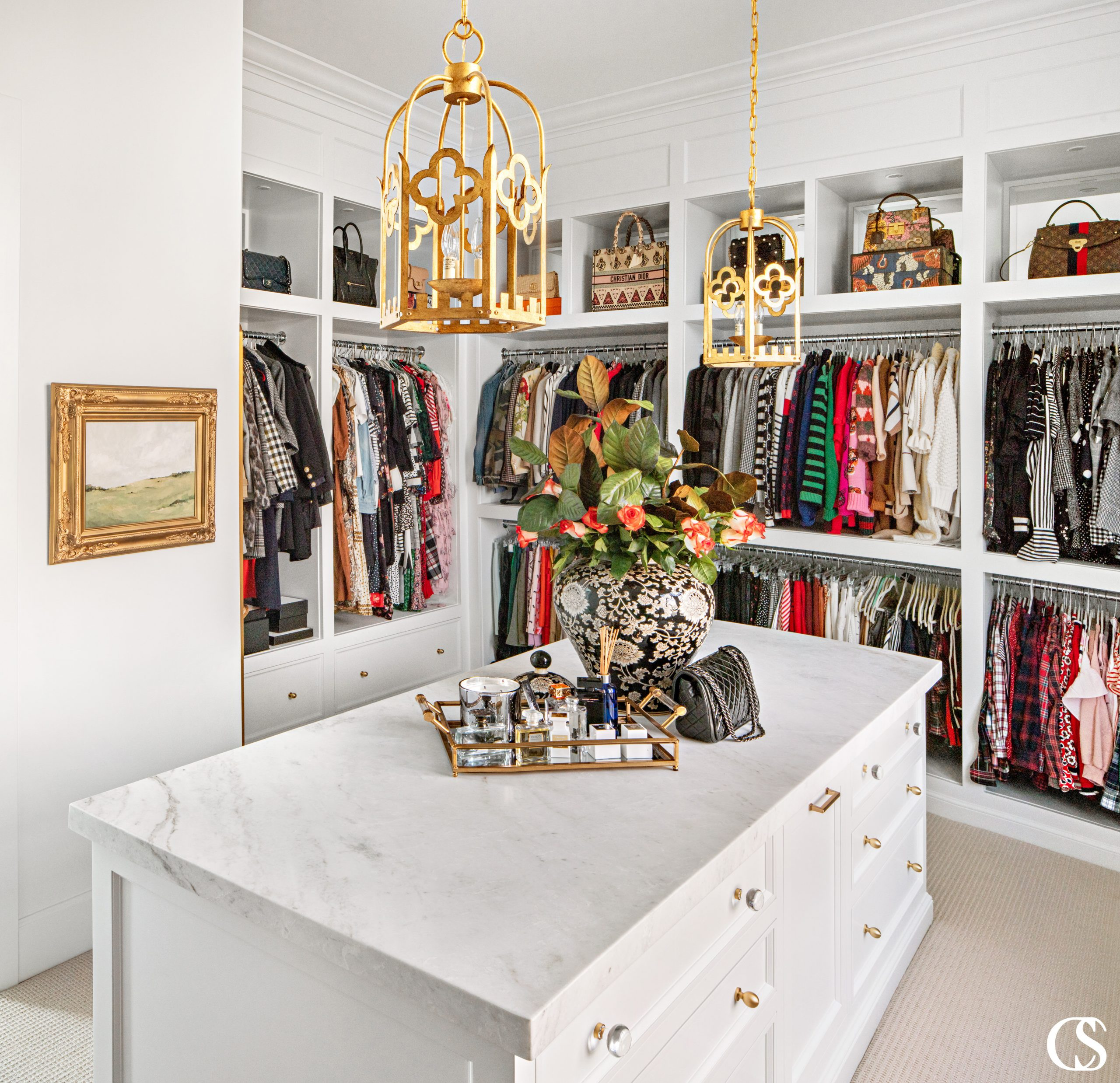 What do you think the best built in cabinets for a closet should entail? We love adding plenty of space for hanging items, but also open shelves for displaying accessories and an island of drawers for delicates and jewelry.