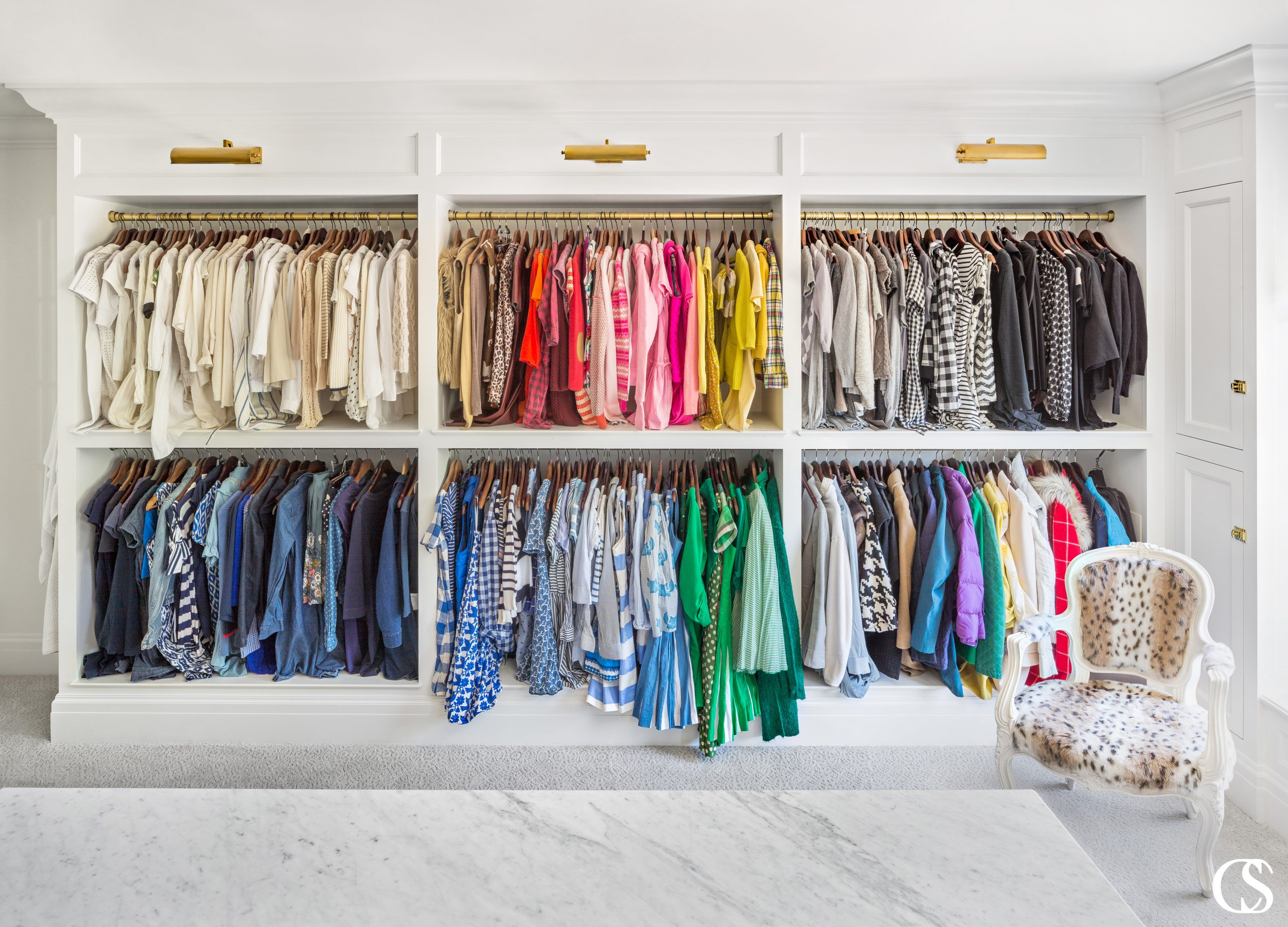 The best built in custom cabinet for your closet should be a springboard for your items to shine and be easily found—even if you don't organize by the rainbow ;)