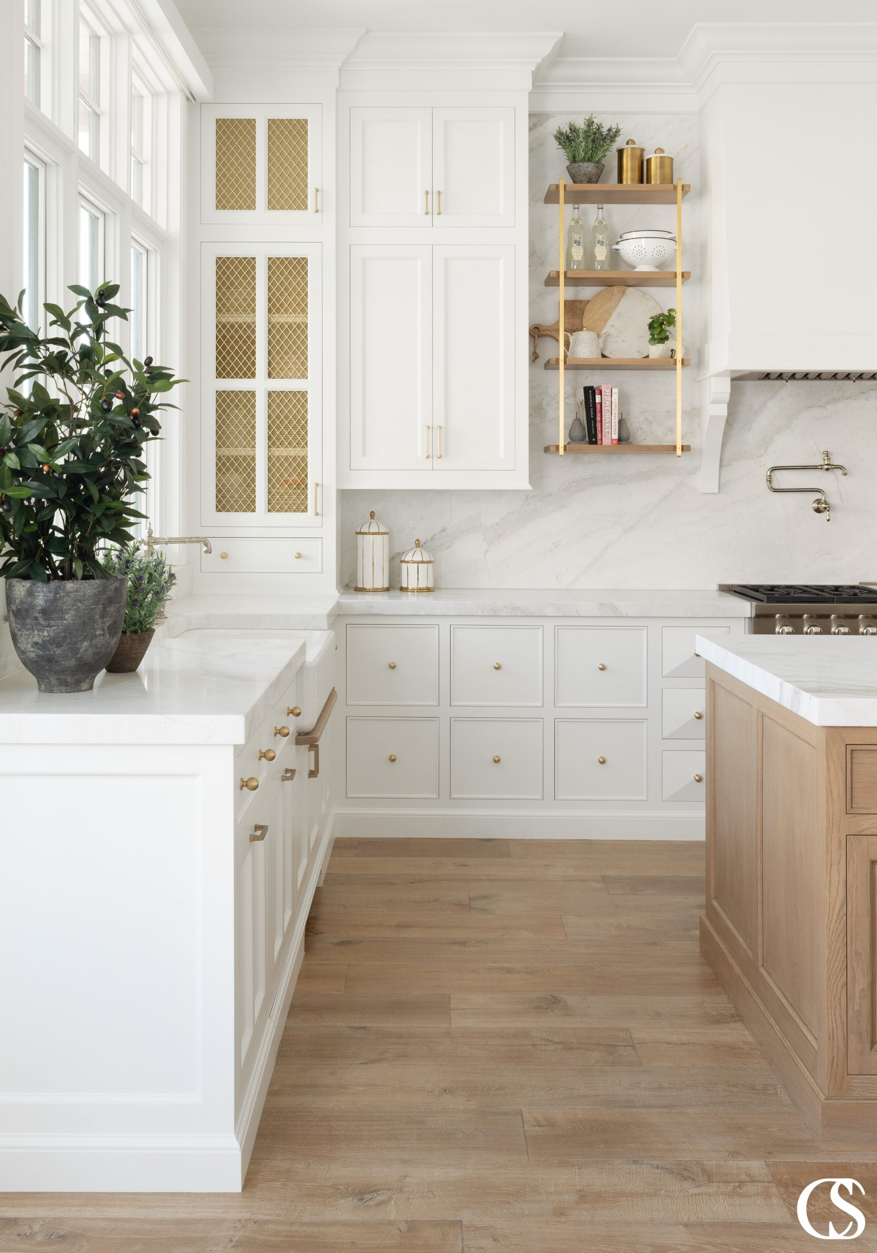 Open shelving, mullioned cupboards, dimensional cabinet doors, and a complementary wood island all come together in some of the best built in custom cabinetry out there.