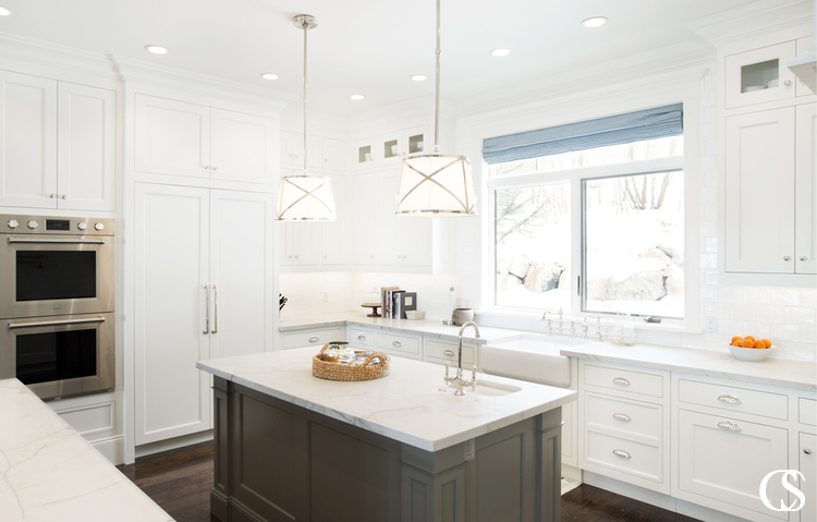 Often the best cabinets for kitchen design also include an island to increase work space and add conveniences like an extra rinsing sink.