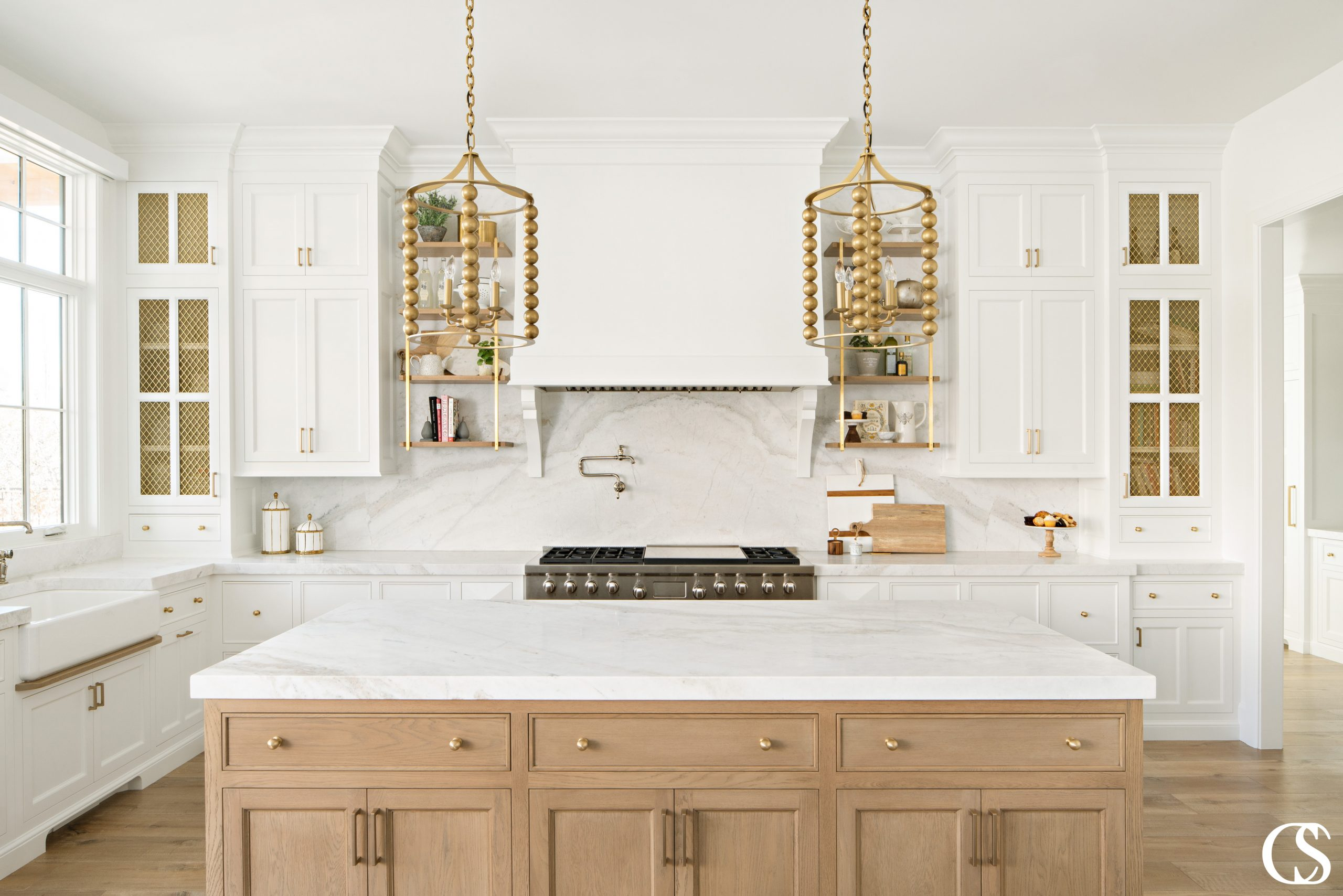 See how the wood island also uses beaded inset drawers and shaker cabinet doors to echo the look in the rest of the kitchen? It's those kind of consistencies that make the best cabinets for kitchen design a harmonious success.