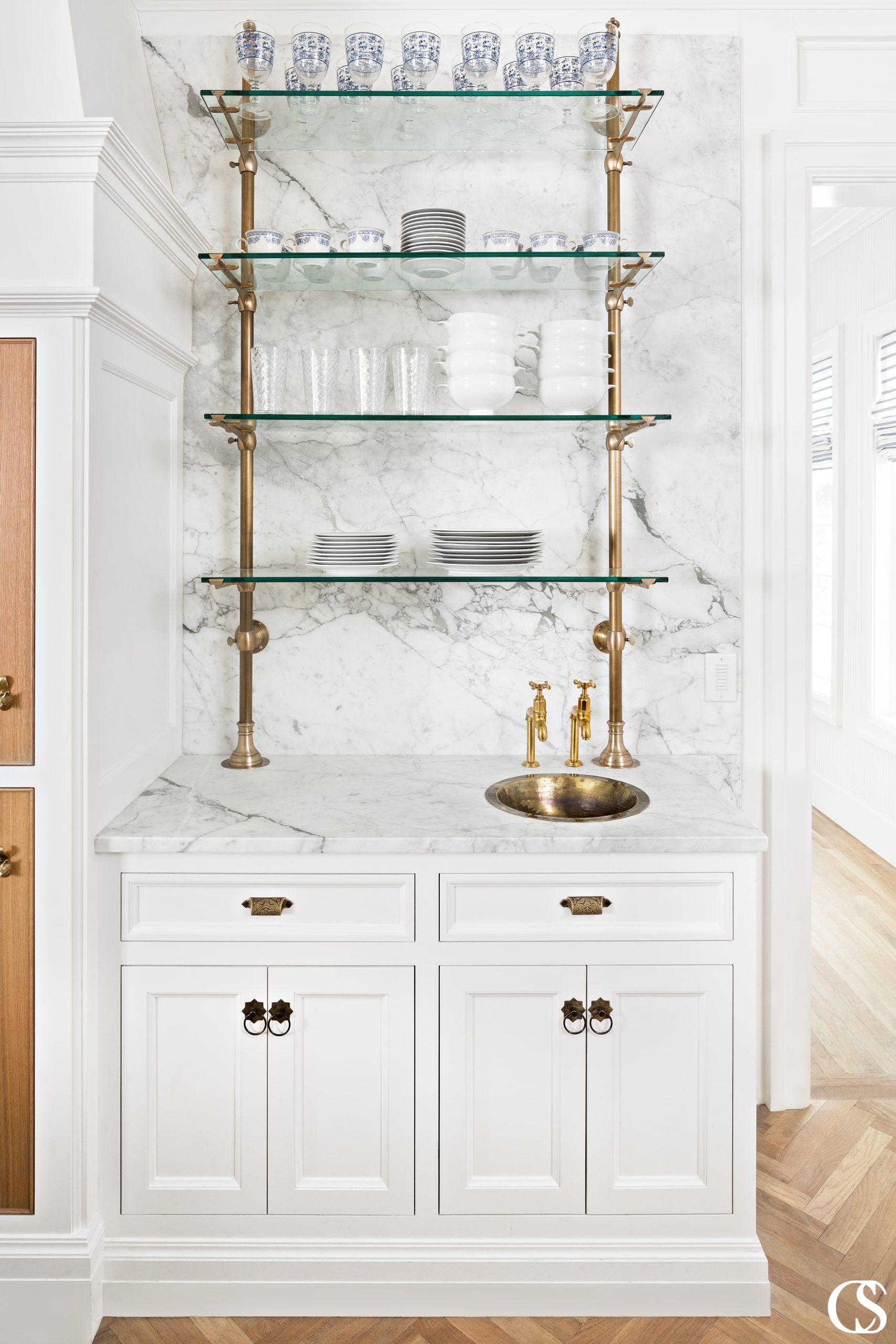 Glass and brass combine here to make a great bar space in this custom kitchen design.