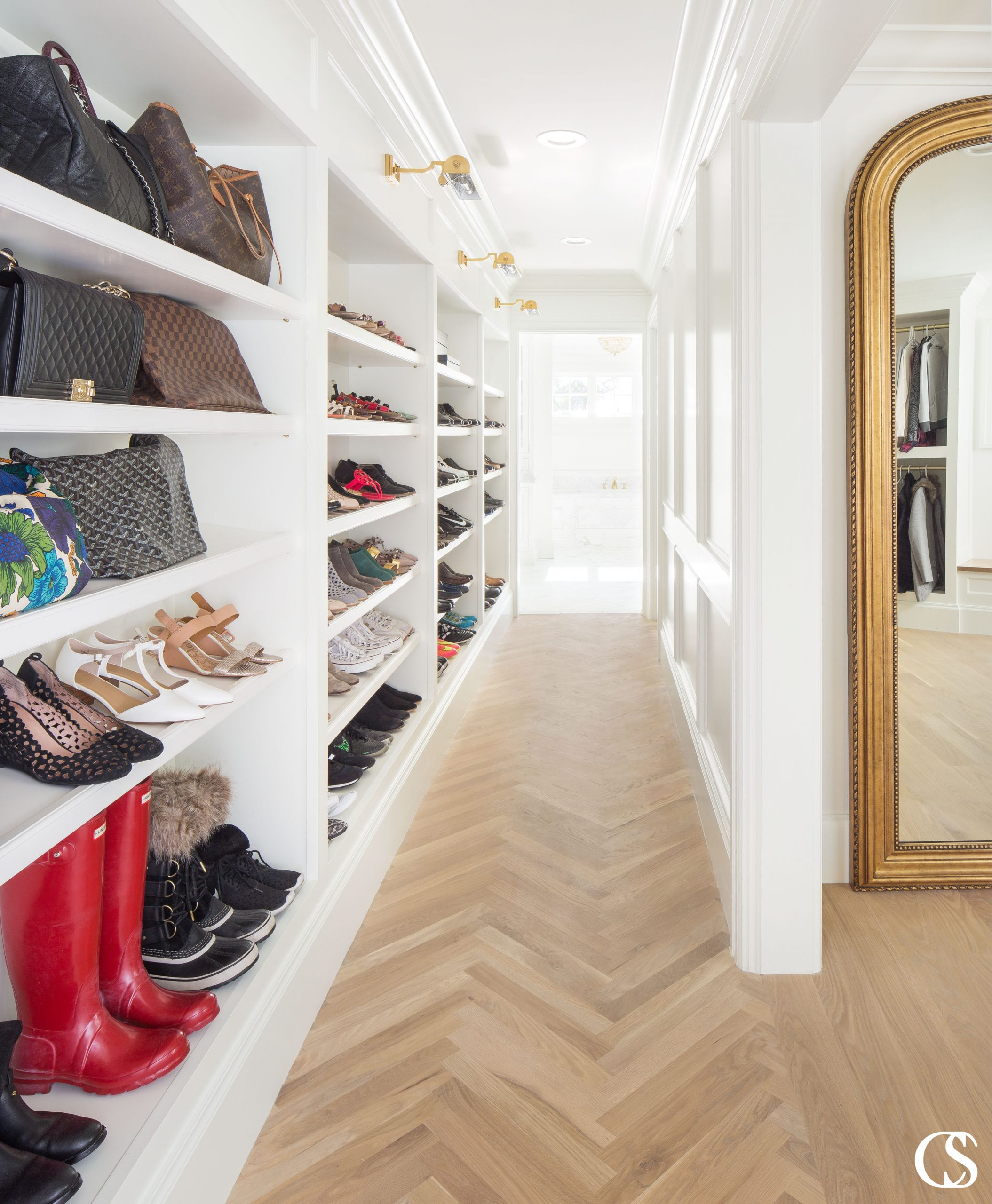 There is no shame in having a shoe collection to rival a department store's. Even less shame in putting them on display in the best custom built-ins.