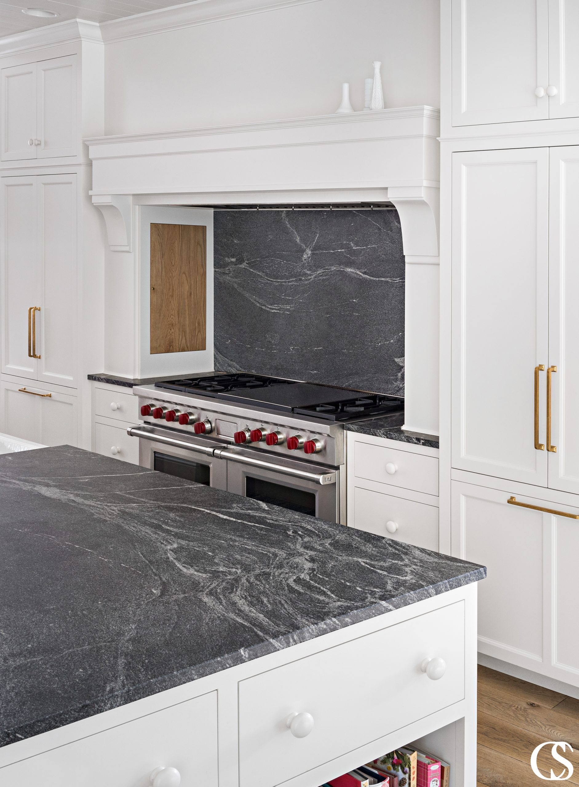 Some of the best custom cabinet design in the kitchen comes complete with a hidden spice cupboard near the stove for easy access during cooking and beautiful kitchen storage.