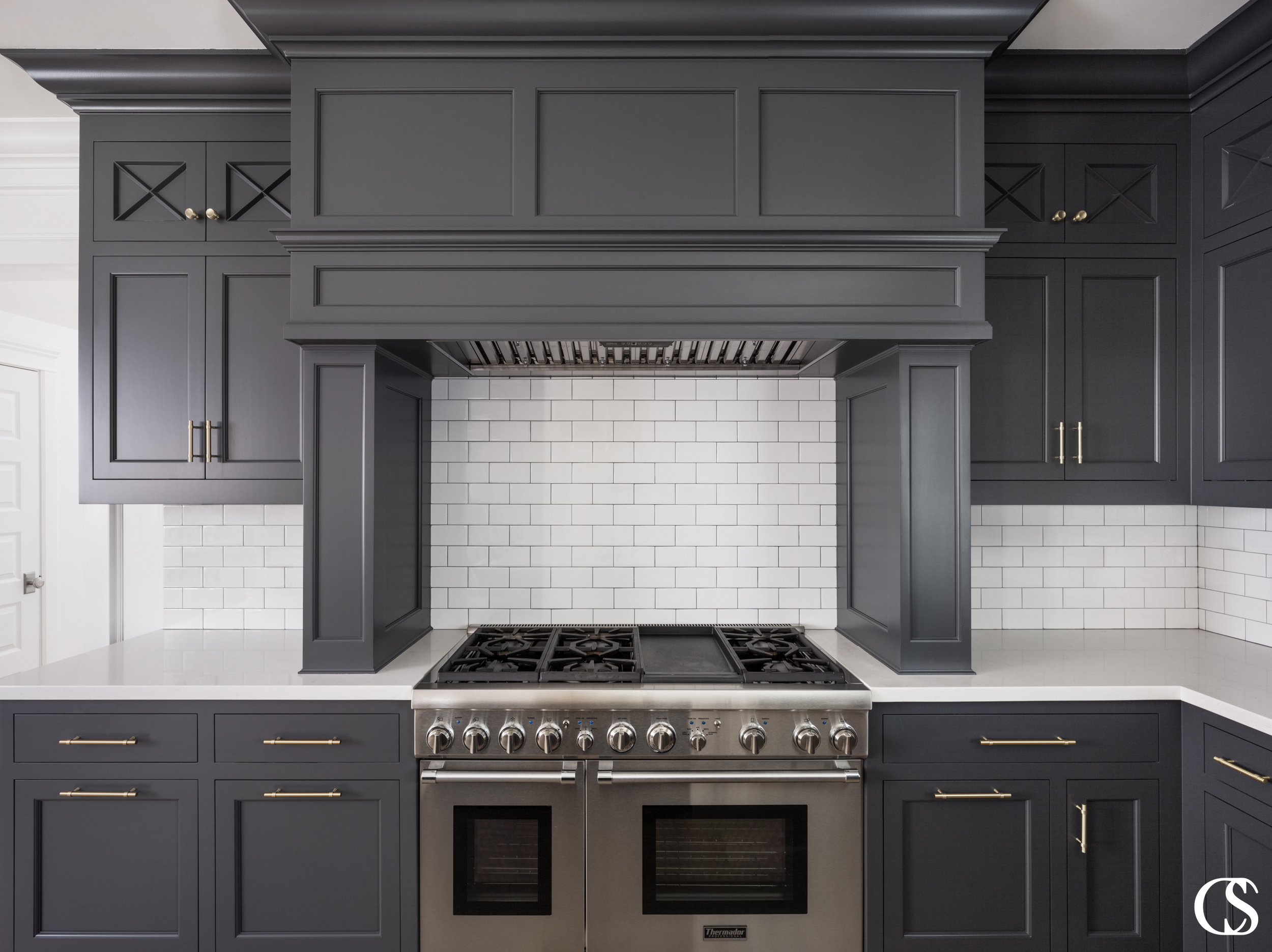 Adding a hood to your custom cabinet design completes the look in your kitchen in a way no store-bought piece ever could.