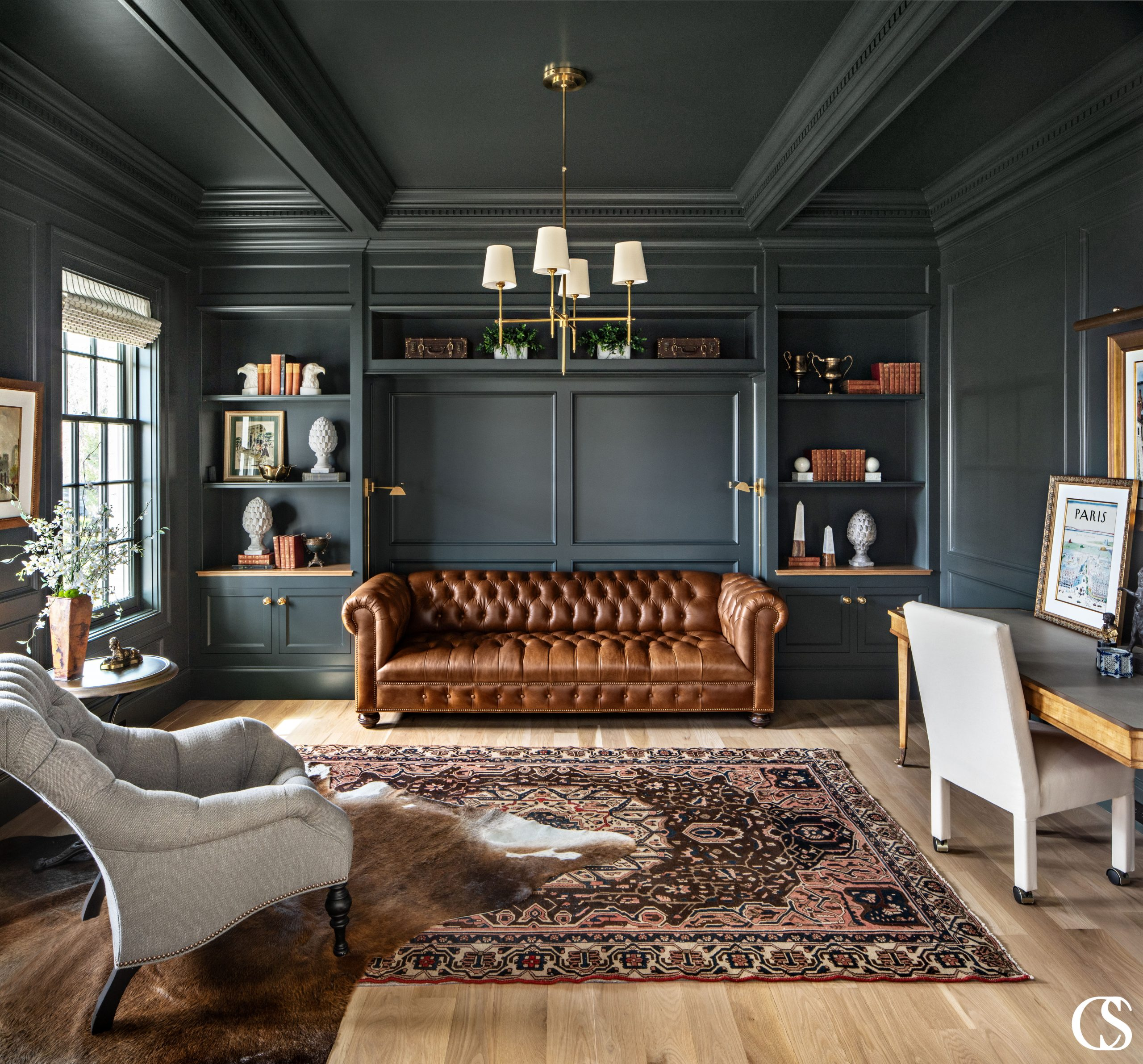 There should be no questioning why this is one of our favorite green paint colors. It's deep, moody, and adds just the right amount of earthiness for the leather and wood to pop off in this custom home office.