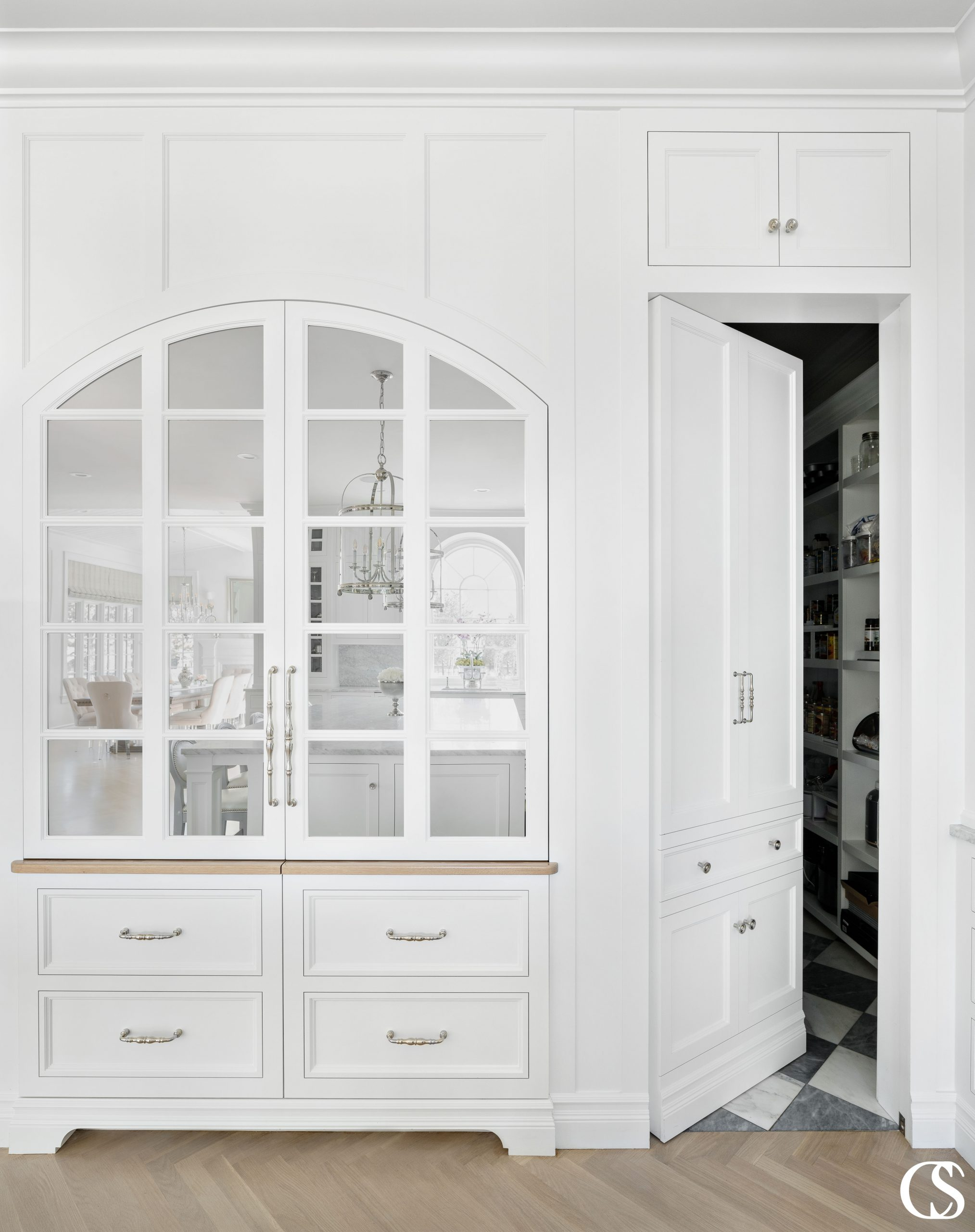 """Some of the best custom cabinets designed for the kitchen incorporate pieces that aren't actually cabinets at all—like this """"hidden"""" door to the pantry."""